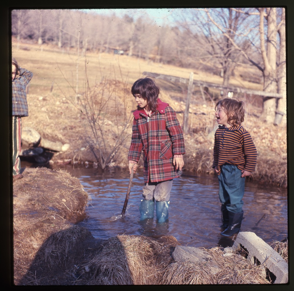 Kids standing in stream, Montague, March 1975