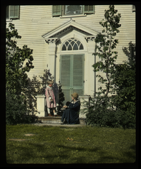 Hulot House, So. Amherst - Woman and child on stoop