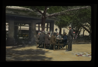 Playing Dominoes, St. Augustine (men gathered around table in public square), delicate slide