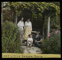 Cozy Little Garden House (man and boy on stoop, two women standing)