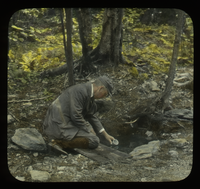 Mt. Everett, the spring Prof. A. K. Harrison (man collecting water in a cup from a small pool)