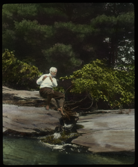 Orient brook (Prof Waugh? Playing the flute on a rock by a stream)
