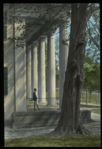 Boy on porch with huge white columns
