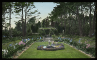 "Jones Garden, Cape Cod ""The moonlight Garden"" (perennial borders, sculpture, framed by large pines)"