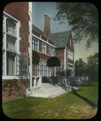 House and Garden at Rye, New York (Formal, brick house and stone patio)
