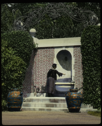 Francis Maxwell Place (woman near fountain framed by large colored urns)