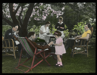 Supper in the Garden (family group under flowering tree)