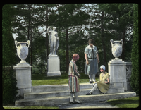 Dakin garden ( young woman sitting on stone steps near urns and statue)