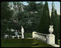Dakin Garden (boy talking to girl on stone bench, Urns, formal stonework)