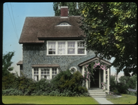 J C Evaham, Amherst (blue-gray wood shingled house with foundation plantings)