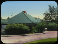Train station with green- shingled roof
