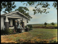 Oklahoma bungalow (white home beside large field, family on front stoop)