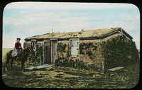 Homesteader's House, western Canada (woman on horse in front of sod house)
