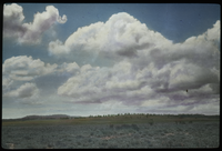 Large clouds, distant hills, plains