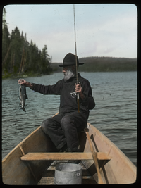 Lake Trout - Lake Vassal, P.Q. (elderly man fishing in a rowboat on lake)