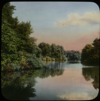The Lake Graceland Cemetery, O.CA.  Simmons (body of water surrounded by trees and shrubs)