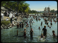 Fresh water bathing area crowded with swimmers