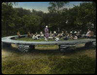Columbia Park, Chicago (people sitting around and inside a large horseshoe shaped bench)