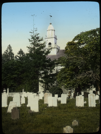 Cemetery and white wooden church or meeting house