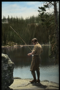 Wallowa Mountains, Oregon (woman fishing in lake)