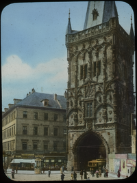 Old City Gate - Prague (ornamented gothic style tower gate, people and trolley along street)