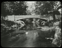Cement arch bridge over river
