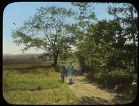 Man and woman on dirt road in meadow