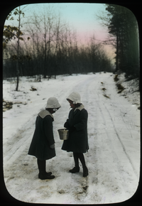Two Girls standing on snowy road