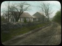 Roadside view- unidentified (stonewall, house and barn along road)