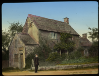 Worcestershire Cottage (two story store house with front garden and climbing vine, elderly man standing in front)