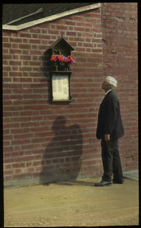 War Memorial, Canterbury (man looking at plaque on brick wall)