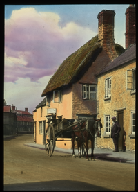 Bicester, England (road with horse-drawn carriage lined with buildings)