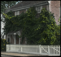 Nantucket (two story house with white picket fence)