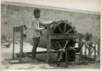 [Chinese boy and girl working with loom]