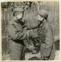 Bailie School in Chengdu [boys in uniform shaking hands]