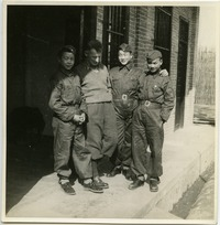 [Bailie School in Chengdu: three boys in uniform with Rewi Alley(?)]