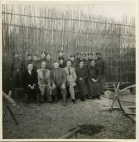 [Bailie School in Chengdu: group shot with students and instructors: Rewi Alley seated third from left, Andrew Braid fourth from left]