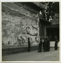 Bailie School in Chengdu [boys in uniform pointing at  artwork]