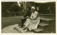 Yeomans and unidentified nurse, seated on steps