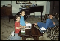 Three children in living room