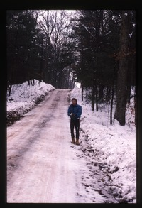 Boy on snowy road