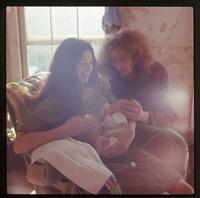 Nina feeding baby (Eben), Chuck