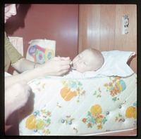 Nina spoon feeding baby (Eben)