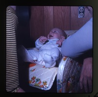 Baby (Eben) in baby seat, laughing