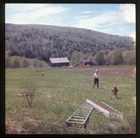 Nina's mother and baby (Eben?) in field above Montague farm, looking south over house and barn.