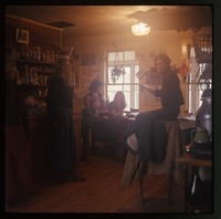 People in the kitchen, Montague (Seabrook No Nukes poster on wall)