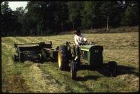 Dan driving John Deere tractor, baling hay, Wendell(?)