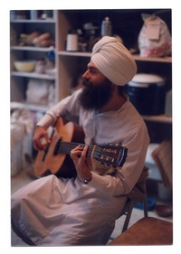 Gurushabd Singh (Stephen Josephs) playing guitar
