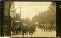 Crowd gathering in the street, possibly Ilion, N.Y.