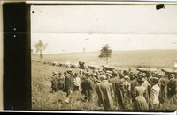 Crowd gathered in a field